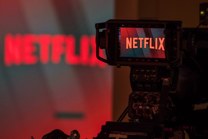 A television camera focuses on the Netflix Inc. company logo in this arranged photograph in London, U.K.,
